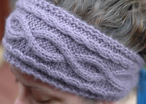 A knitted purple Ear Warmer