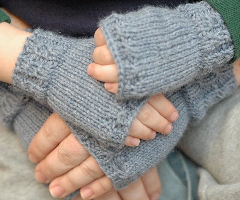 Matching pairs of handknitted fingerless mitts