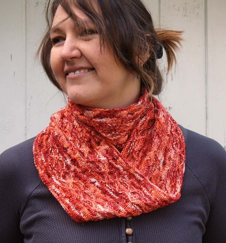 A hand knit long loop cowl doubled around the neck in SoftnShiny hand dyed yarn