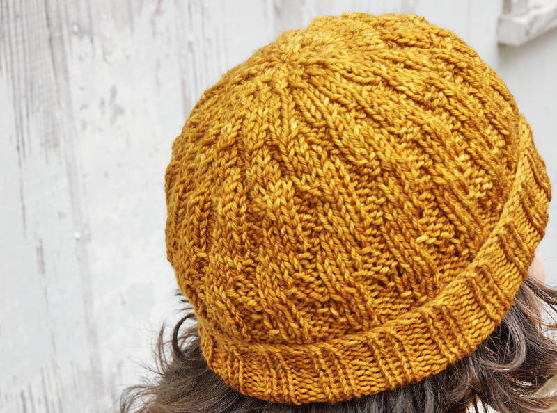 Detail of the crown of a hand knitted hat