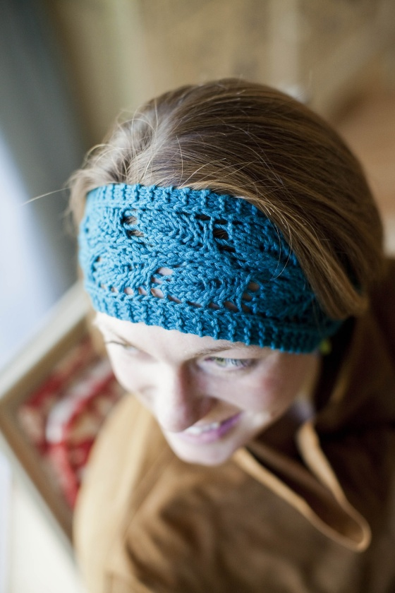 A hand knit lace headband