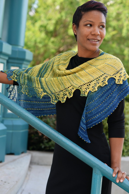 BitterBlue - a lace shawl in gradient yarn with gradient beads, by Barbara Benson.