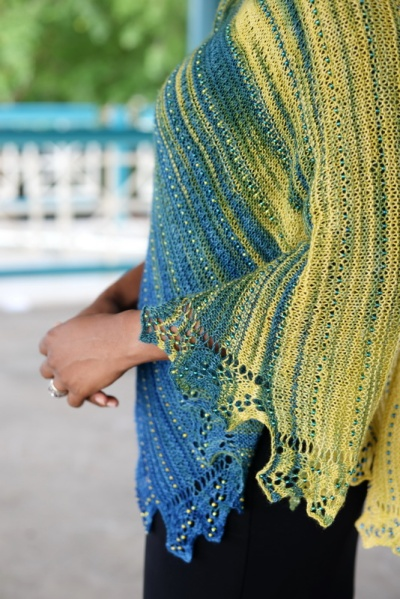 Lace shawl worked in gradient yarn with gradient beads by Barbara Benson.