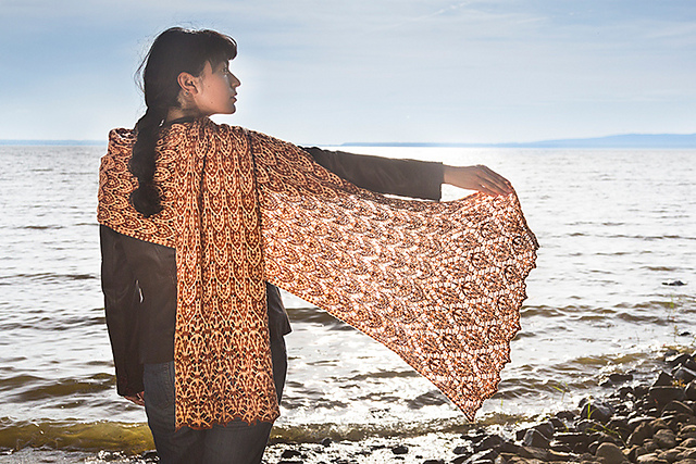 A knitted stole combining mosaic style color-work and Estonian lace from Barbara Benson