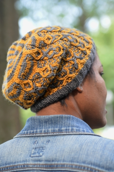 Cables are Cool: A two color cable hat featuring slipped stitch color work by Barbara Benson