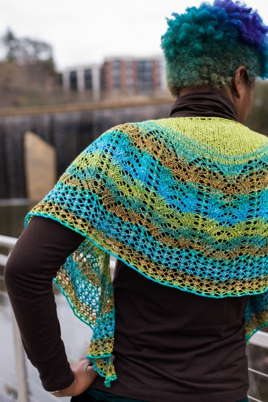 Each to Each by Barbara Benson: a beaded, crescent shaped shawl knit in a gradient yarn.